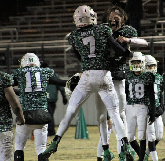 Blackwell's Brendan Scott (7) celebrates with a teammate Michael Lowry after the Hornets closed out Throckmorton 46-0 to win their Class 1A DII regional playoff game Friday at Baird.
