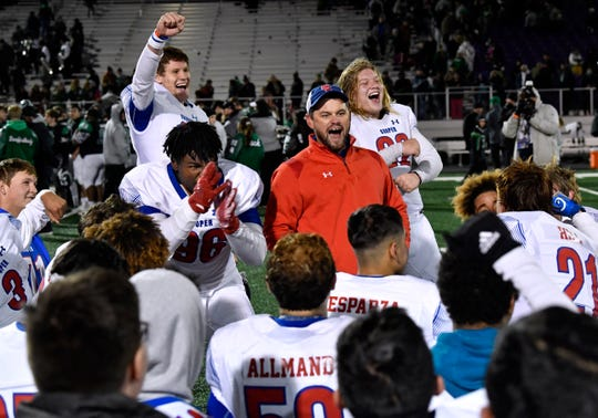 Cooper coach Aaron Roan cheers with his team after defeating Azle in a Region 1-5A Division 1 area playoff game Nov. 22 at Tarleton State University in Stephenville Nov. 22, 2019. Cooper won 23-28.