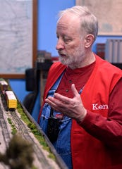 Ken Riediger watches one of this trains roll down the track on his personal model railroad Saturday.