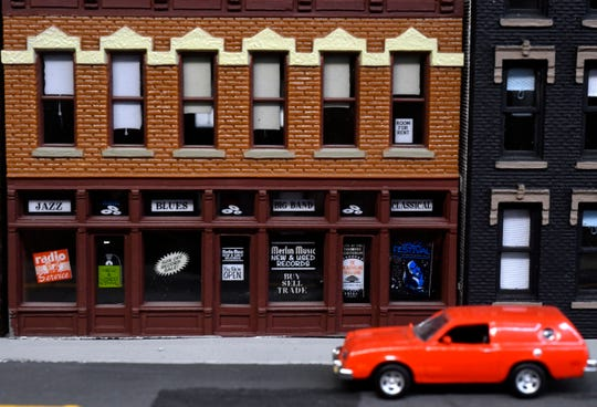 A tiny storefront and parked car in Ken Riediger's model railroad Saturday.