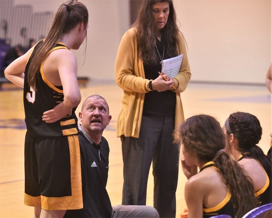 Seminole coach Tri Danley, near left, talks his team during a timeout. Wylie beat the Maidens 49-35 in the third-place game of the Polk-Key City Classic on Saturday.