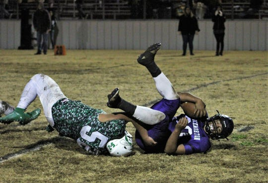 Blackwell's Joel Guia (52) brings down a Throckmorton ballcarrier for a short gain during Friday's Class 1A DII playoff game at Baird. The Hornets won 46-0.