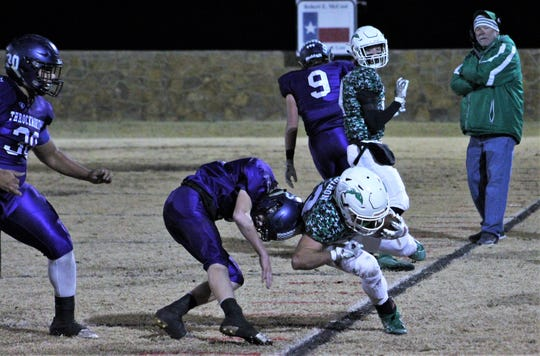 Blackwell's Cameron Coldiron (23) is helmet-butted out of bounds during the first half of their Class 1A DII regional playoff game Friday at Baird. The Hornets advanced in the playoffs and to 12-0 on the season with a 46-0 shutout.