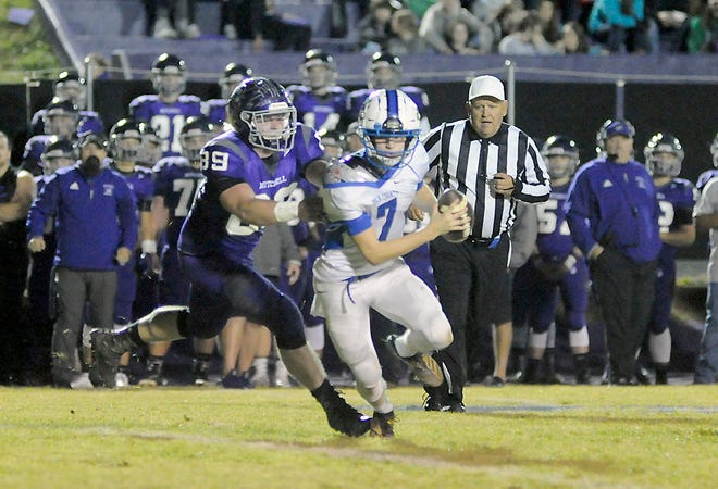 Cole Sparks sacks Polk County quarterback Bryce Jergenson to halt a long Wolverine drive in the second quarter of Friday's 1AA playoff game in Ledger.