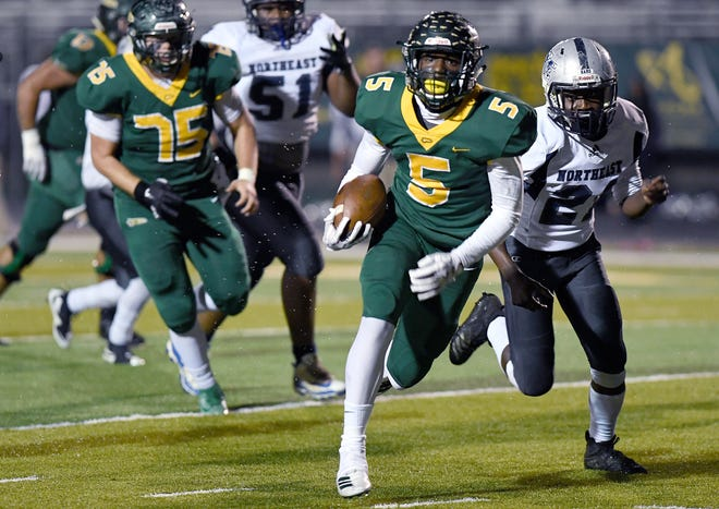 Reynolds' Jhari Patterson outruns Northeast Guilford's Prince Thompson as he runs for a touchdown during their second-round playoff game at Reynolds High School on Nov. 22, 2019.