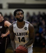 "Albion College junior guard Jamezell Davis (14) shoots a free throw during a game against Earlham at Kresge Gymnasium on Friday, Nov. 22, 2019 in Albion, Michigan. The Britons are wearing ""ZW"" patches this season in honor of their late teammate, Zachary Winston."