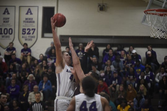 Albion College junior forward Caden Ebeling (42) scores two of his game-high 31 points as Albion defeated Earlham, 95-71, on Friday, Nov. 22, 2019 at Kresge Gymnasium in Albion, Michigan.