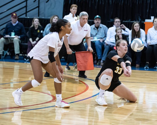 Farmington Hills Mercy's Jess Mruzik (33) and Amina Robinson (7) during MHSAA State Finals at Kellogg Arena on Nov. 23, 2019.