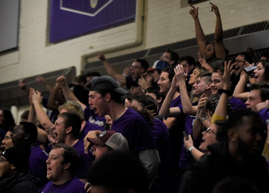 The Albion College student section celebrates during the Britons' 95-71 victory over Earlham on Friday, Nov. 22, 2019 at Kresge Gymnasium in Albion, Michigan.