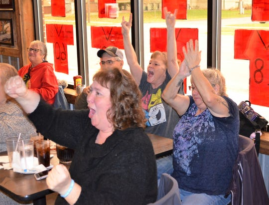 Colon fan Terri Vallance, center, leads the cheers as the Magi score as the community packed Curly's Bar and Restaurant on Saturday to watch the MHSAA 8-player Division 1 state championship game, won by the Magi.