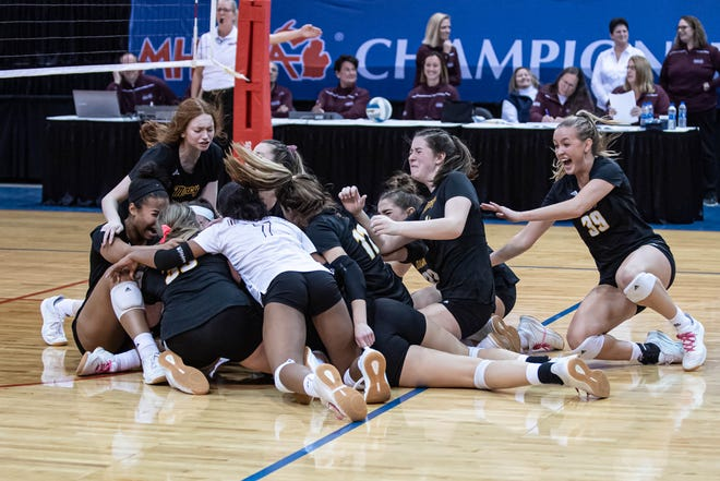 Farmington Hills Mercy celebrates its MHSAA Division 1 Volleyball State championship victory over Lowell on Saturday, Nov. 23, 2019 at Kellogg Arena in Battle Creek.