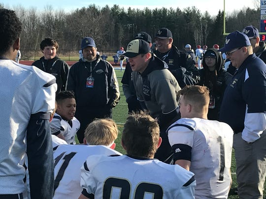 Susquehanna Valley coach Mike Ford talks to his team after the Sabers' 35-28 state semifinal victory over Southwestern on Saturday at Cicero-North Syracuse.