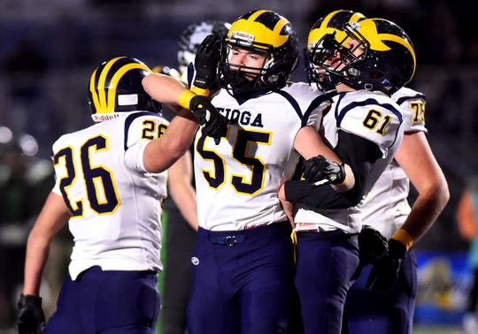 Tioga's Emmett Wood (26), Bryce Mashas (55) and Ryan Rockwell (61) celebrate a touchdown during the first half of action duringClymer/Sherman/Panama vs. Tioga, Class D semifinal football at Cicero-North Syracuse High School. CSP defeated Tioga with a final score of 28-27. Friday, November 22, 2019.