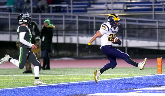 Tioga's Emmett Wood (26) scores a touchdown during the first half of action duringClymer/Sherman/Panama vs. Tioga, Class D semifinal football at Cicero-North Syracuse High School. CSP defeated Tioga with a final score of 28-27. Friday, November 22, 2019.
