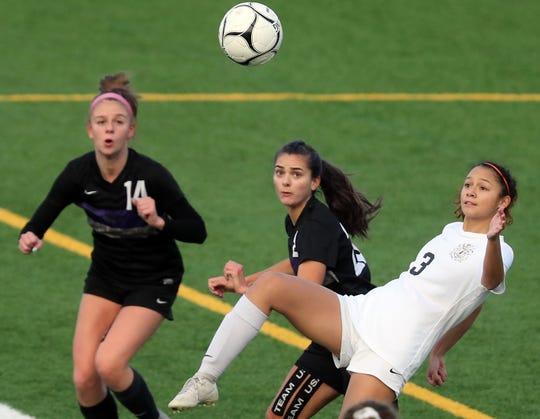 Central Kitsap's Paris Agana (3) makes a high kick against Lake Washington in Puyallup on Friday, November 22, 2019.