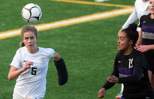 Central Kitsap's Marielle Arnold (left) is the Kitsap Sun girls soccer player of the year for 2019. She helped led the Cougars to third place in the Class 3A state tournament.