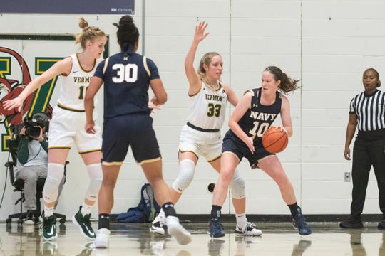 Vermont's Delaney Richason (33) guards Navy's Laurel Jaunich (10) during the women's basketball game between the Navy Midshipmen and the Vermont Catamounts at Patrick Gym on Friday night November 22, 2019 in Burlington, Vermont.