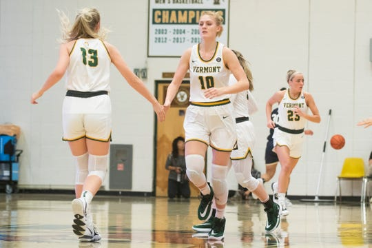 Vermont's Hanna Crymble and Jane McCauley (13) high five during the women's basketball game between the Navy Midshipmen and the Vermont Catamounts at Patrick Gym on Friday night November 22, 2019 in Burlington, Vermont.