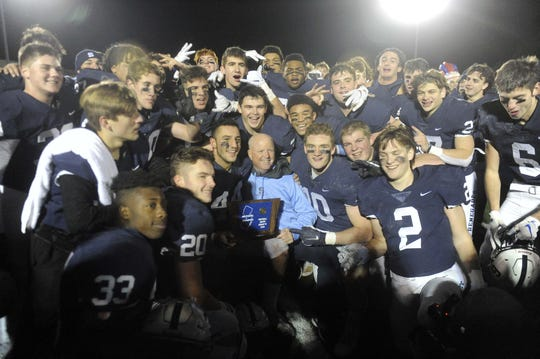 The Shawnee High School football team celebrated the South Jersey Group 4 title with a 28-0 win over Ocean City on Friday.