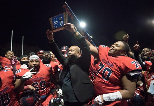 Willingboro High School football coach Steve Everette hoists the championship trophy after Willingboro defeated Salem, 40-8, in the Central Jersey Group 1 football final played at Willingboro High School on Friday, November 22, 2019.