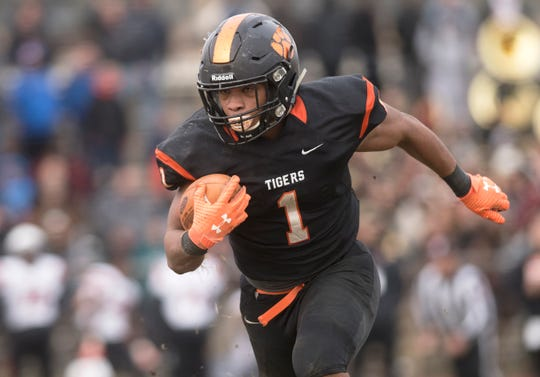 Woodrow Wilson's Muheem McCargo runs an interception for a touchdown during the 3rd quarter of the South Jersey Group 3 championship game between Woodrow Wilson and Somerville, played at Woodrow Wilson High School in Camden on Saturday, November 23, 2019.  Woodrow Wilson defeated Somerville, 54-30.