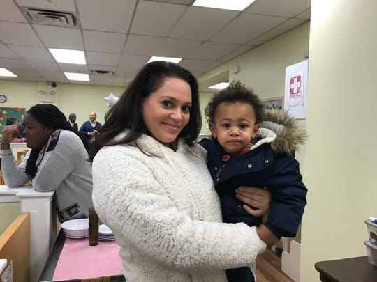 Cessilee Quiles holds her son, Casheen Temple, at Respond Inc.'s daycare center in North Camden.