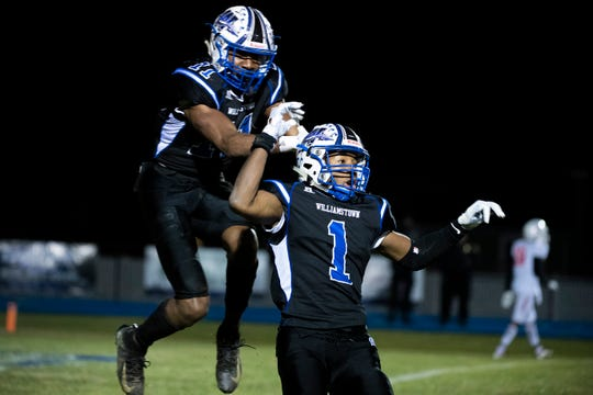 Williamstown's Mekhi Gamble (1) and Donovan Ezeiruaku (11) celebrate a touchdown that was called back against Lenape during a South Jersey Group 5 championship Friday, Nov. 22, 2019 in Williamstown, N.J. Williamstown won 14-10.