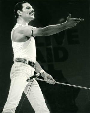 Freddie Mercury with Queen on stage at Live Aid on 13 July 1985 at Wembley Stadium, London.