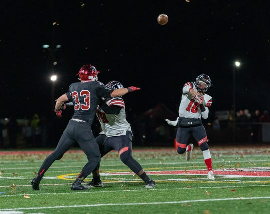 The Woodbridge and Northern Highlands high school football teams met Friday night in the NJSIAA North 1 Group IV final.