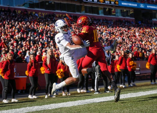 Iowa State freshman defensive back Tayvonn Kyle (10) breaks up a potential touchdown pass to Kansas junior receiver Stephon Robinson Jr., in the third quarter on Saturday, Nov. 23, 2019, at Jack Trice Stadium in Ames.
