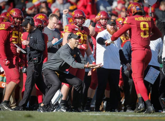 Iowa State head football coach Matt Campbell celebrates with defensive end Will McDonald after McDonald sacked Kansas quarterback Carter Stanley in the second quarter on Saturday, Nov. 23, 2019, at Jack Trice Stadium in Ames.