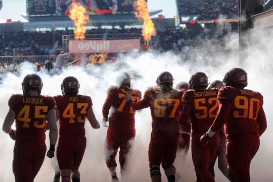 Members of the Iowa State Cyclones football team take the field prior to kickoff against Kansas on Saturday, Nov. 23, 2019, at Jack Trice Stadium in Ames.