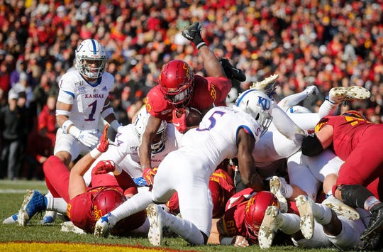 Iowa State freshman running back Breece Hall leaps over the Kansas defense for a touchdown in the second quarter on Saturday, Nov. 23, 2019, at Jack Trice Stadium in Ames.