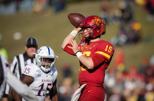 Iowa State sophomore quarterback Brock Purdy lobs a pass to freshman running back Breece Hall for a touchdown connection in the fourth quarter against Kansas on Saturday, Nov. 23, 2019, at Jack Trice Stadium in Ames.