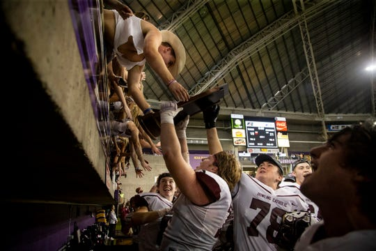 Dowling Catholic celebrates after they beat Valley 21-16 in their Class 4A state football championship game at the UNI Dome on Friday, Nov. 22, 2019, in Cedar Falls.