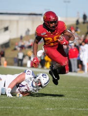 Iowa State freshman running back Breece Hall breaks a tackle in the second quarter against Kansas on Saturday, Nov. 23, 2019, at Jack Trice Stadium in Ames.