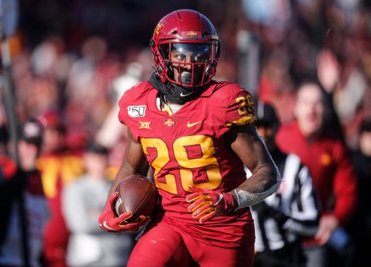 Iowa State freshman running back Breece Hall runs in a touchdown reception in the fourth quarter against Kansas on Saturday, Nov. 23, 2019, at Jack Trice Stadium in Ames.