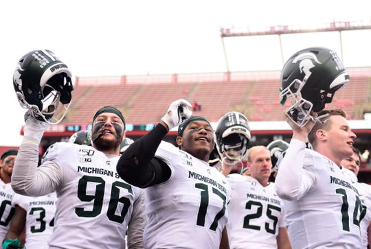 PISCATAWAY, NEW JERSEY - NOVEMBER 23: The Michigan State Spartans sing their alma mater after their 27-0 win over the Rutgers Scarlet Knights at SHI Stadium on November 23, 2019 in Piscataway, New Jersey. (Photo by Emilee Chinn/Getty Images)