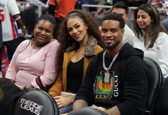 Darius Slay and his wife, Jennifer, watch the Detroit Pistons play the Atlanta Hawks, Friday, Nov. 22, 2019 at Little Caesars Arena.