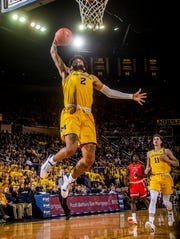Michigan forward Isaiah Livers (2) dunks during the second half of the team's NCAA college basketball game against Houston Baptist in Ann Arbor, Mich., Friday, Nov. 22, 2019. Michigan won 111-68.