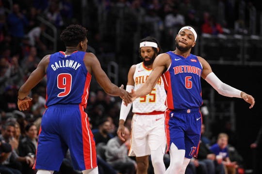 Detroit Pistons guard Bruce Brown (6) high fives guard Langston Galloway (9) during the second quarter against the Atlanta Hawks at Little Caesars Arena on Friday, Nov. 22, 2019, in Detroit.