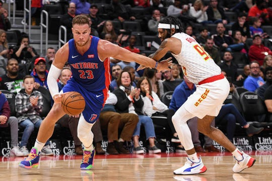 Pistons forward Blake Griffin drives to the basket as Hawks guard DeAndre' Bembry defends during the fourth quarter of the 123-108 win over the Hawks on Friday, Nov. 23, 2019, at Little Caesars Arena.