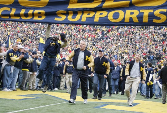 The 1969 Michigan football team enters the field during pregame festivities before the Ohio State game in Ann Arbor, Nov. 21, 2009.