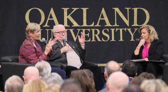 Former Polish President and Nobel Peace Prize winner Lech Walesa, center, at Oakland University's Varner Vitality Speaker Series answers questions with assistance from translator Magdalena Maria Iwinska, left,  from Detroit Free Press Columnist Carol Cain who moderated the conversation at its Nov. 15 event.