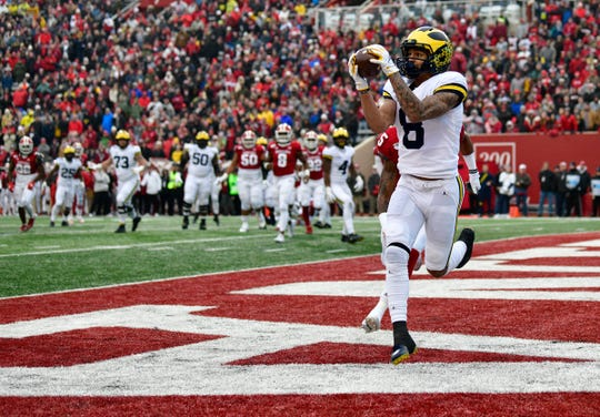 Nov 23, 2019; Bloomington, IN, USA; Michigan Wolverines wide receiver Ronnie Bell (8) catches a ball in the end zone for a touchdown during the first quarter of the game against the Indiana Hoosiers at Memorial Stadium . Mandatory Credit: Marc Lebryk-USA TODAY Sports