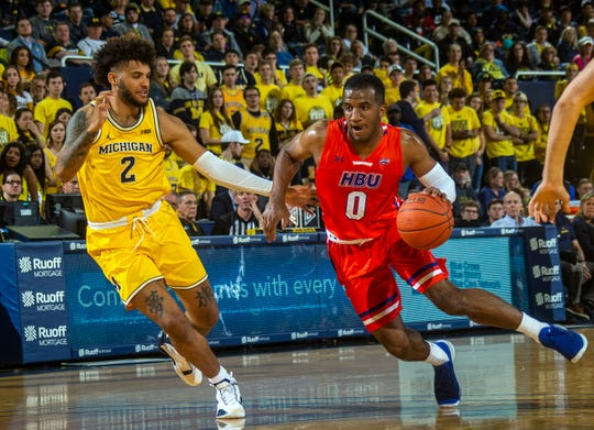 Michigan forward Isaiah Livers (2) defends against Houston Baptist guard Ian DuBose (0) during the first half of an NCAA college basketball game in Ann Arbor on Nov. 22, 2019.