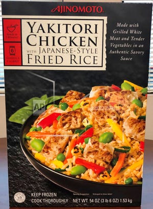 """This photo provided by the Food Safety and Inspection Service of the United States Department of Agriculture shows the packaging  """"Ajinomoto Yakitori Chicken With Japanese-Style Fried Rice."""