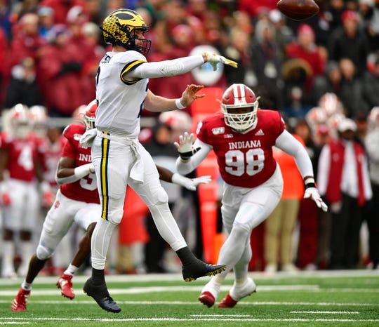 Nov 23, 2019; Bloomington, IN, USA; Michigan Wolverines quarterback Shea Patterson (2) throws the ball under coverage from Indiana Hoosiers defensive lineman Jerome Johnson (98) during the first quarter of the game at Memorial Stadium. Mandatory Credit: Marc Lebryk-USA TODAY Sports