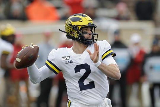Michigan quarterback Shea Patterson throws during the first half against Indiana, Saturday, Nov. 23, 2019, in Bloomington, Ind.