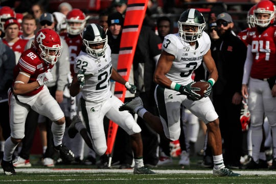 Michigan State safety Xavier Henderson (3) runs with the ball after intercepting a pass intended for Rutgers wide receiver Christian Dremel (82) during the first half of an NCAA college football game Saturday, Nov. 23, 2019, in Piscataway, N.J. (AP Photo/Adam Hunger)